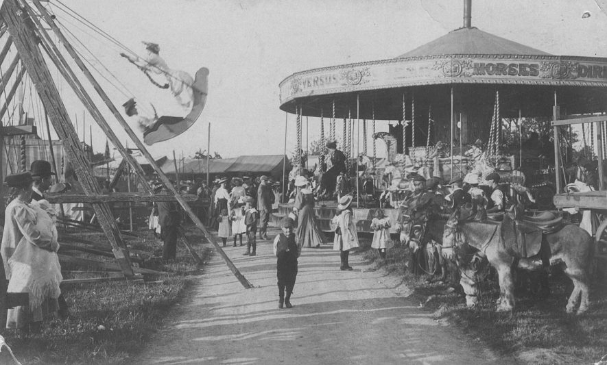 Stockton club week fair, with merry-go-round and swing boats.  c.1904 |  IMAGE LOCATION: (Warwickshire Museums. Photographic Collections.)