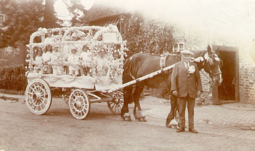 A horse drawn decorated cart full of children in fancy dress at Stockton carnival.  1924 |  IMAGE LOCATION: (Warwickshire Museums. Photographic Collections.)