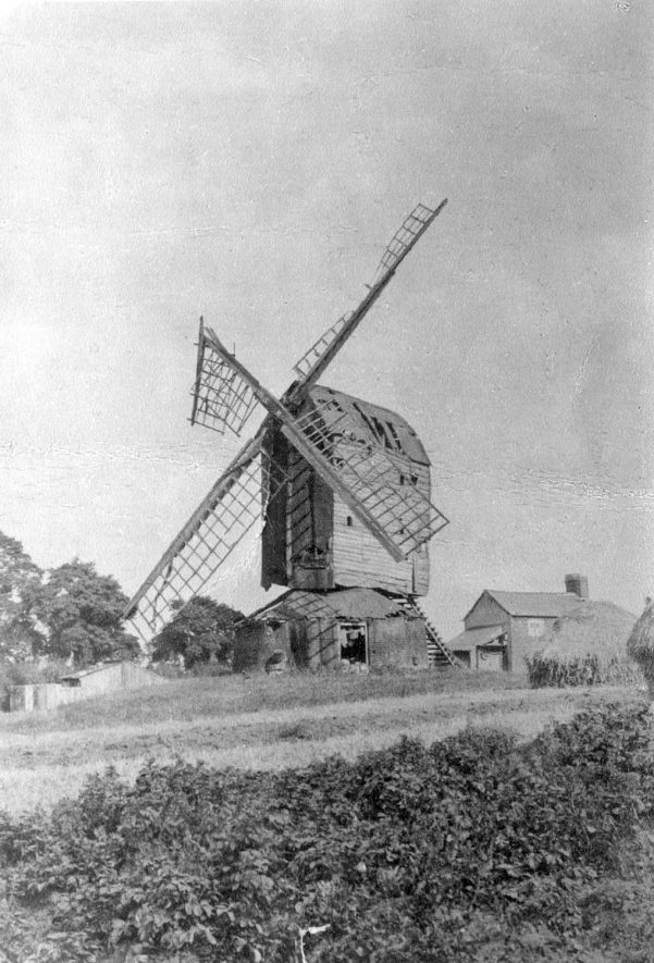 Stockton post windmill falling into disrepair.  1911  Built 1810. Brick and slated roundhouse, 2 pairs stones, 4 common sails, ladder and tailpole with lever. Ceased work 1879. Pulled down with brick tower mill c.1923. |  IMAGE LOCATION: (Warwickshire Museums. Photographic Collections.)