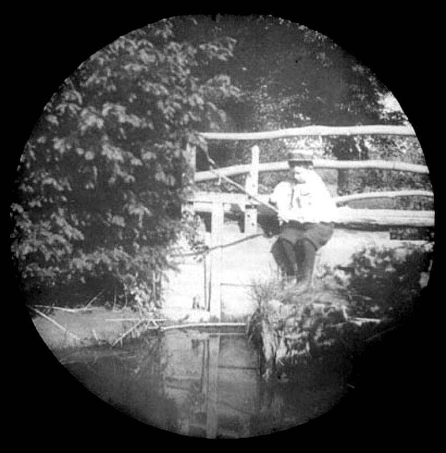 Lower Brailes.  Marshall Findlay (son of the photographer) fishing by a bridge over the Sutton Brook.  1900s |  IMAGE LOCATION: (Warwickshire County Record Office) PEOPLE IN PHOTO: Findlay, Marshall, Findlay as a surname