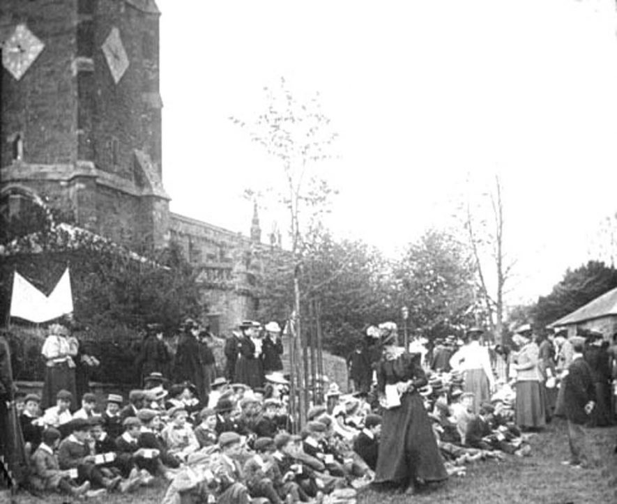 Childrens' picnic outside the church, Lower Brailes, probably on Mafeking Day.  1900. |  IMAGE LOCATION: (Warwickshire County Record Office)