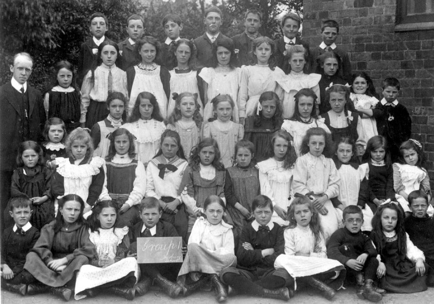 Mr Dickins and group one pupils at Harbury Wight school.  1910 |  IMAGE LOCATION: (Warwickshire Museums. Photographic Collections.) PEOPLE IN PHOTO: Dickins, Mr, Dickins as a surname