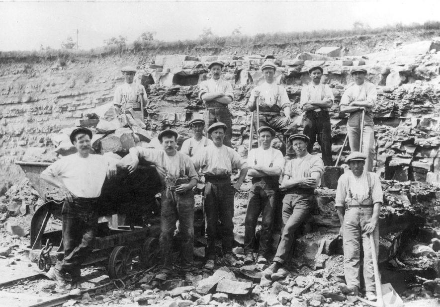 Harbury quarry showing group of workers.  1910s  The following men are believed to be in this photograph: Wilf Wilkins, Mr Over, Mr Lines, Mr Hopkins, Mr Cowley. |  IMAGE LOCATION: (Warwickshire Museums. Photographic Collections.)