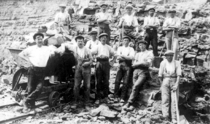 Harbury quarry. A group of workers, some of them named.  1910s  Wilf Wilkins, Mr Over, Mr Lines, Mr Hopkins, Mr Cowley |  IMAGE LOCATION: (Warwickshire Museums. Photographic Collections.) PEOPLE IN PHOTO: Wilkins, Wilf, Wilkins as surname, Over, Mr, Over as a surname, Lines, Mr, Lines as a surname, Hopkins, Mr, Hopkins as surname, Cowley, Mr, Cowley as a surname