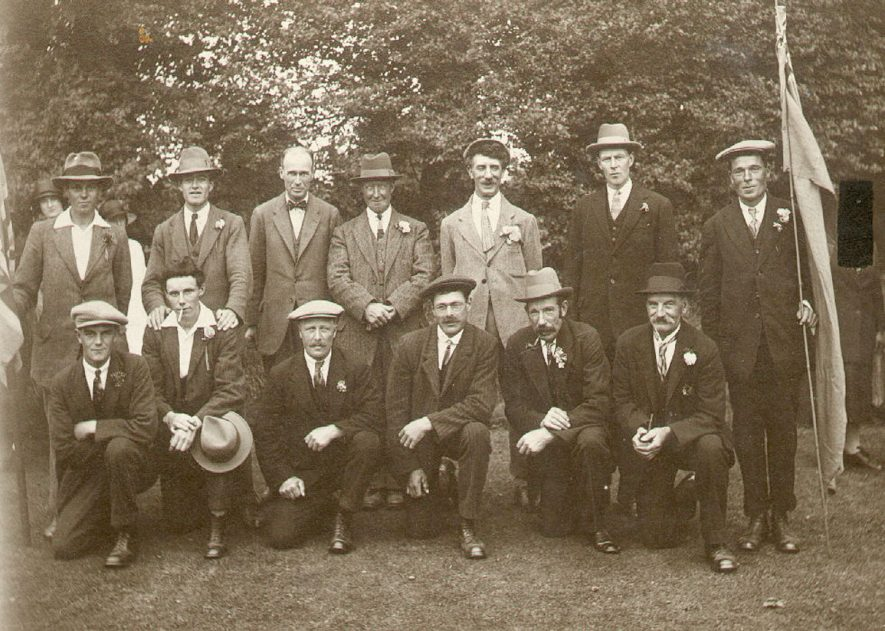 Harbury Union fete group of organisers.  Back row from left to right, Frank Fletcher,  ?, Sabin Smith, Mr Cowley (Sen.), Frank Tidmarsh, Norris Wilkins, Alfie Upton.  Front row from left to right, ?, Curly Fletcher (Stanley), George Lines, ?, Mr Upton (Sen.),  Bill Treen.  circa 1930 |  IMAGE LOCATION: (Warwickshire Museums. Photographic Collections.) PEOPLE IN PHOTO: Wilkins as surname, Wilkins, Norris, Upton as a surname, Upton, Mr (Senior), Upton, Alfie, Treen as a surname, Treen, Bill, Tidmarsh, Frank, Tidmarsh as a surname, Smith, Sabin, Smith as a surname, Lines as a surname, Lines, George, Fletcher, Frank, Fletcher as a surname, Fletcher, Stanley (Curly), Cowley as a surname, Cowley, Mr (Senior)