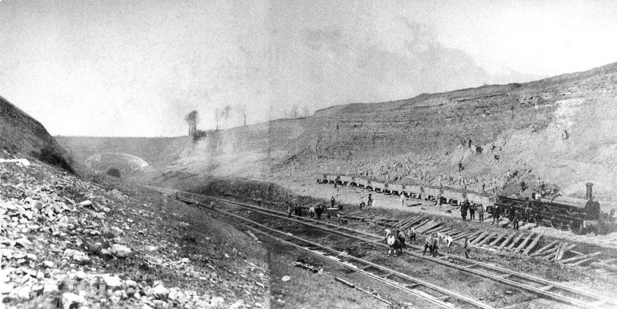Work in progress in excavation of railway cutting, Harbury.  c.1869  [It is thought that this picture shows the quarry siding and limekiln construction. The cutting and railway was opened in 1852 after the origonal tunnel collapsed in 1849. Brunel was brought to the site to see if the project could be rescued after the disaster] |  IMAGE LOCATION: (Warwickshire Museums. Photographic Collections.)