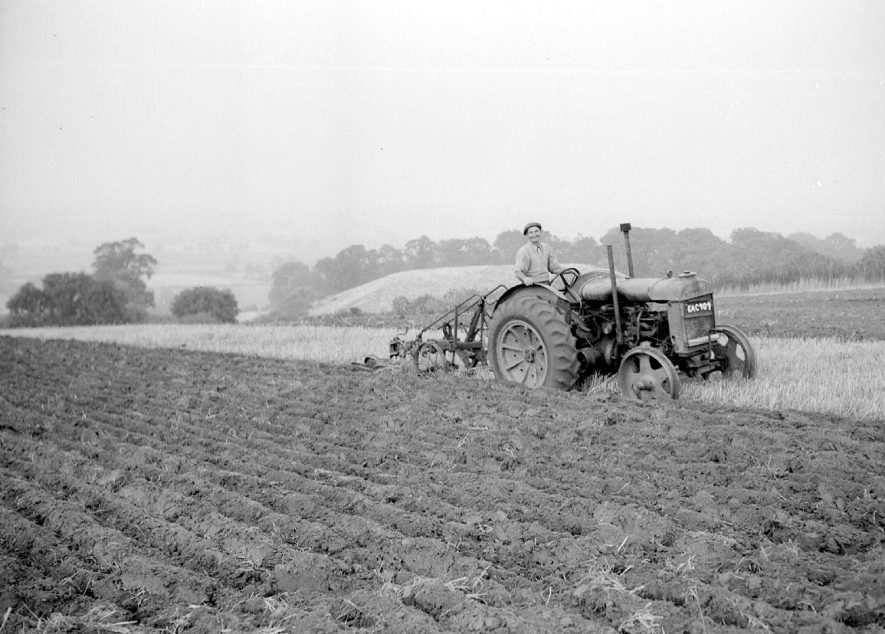 Farmworker on a Standard Fordson tractor ploughing on the Burton Dassett hills. April 19th 1955[The plough is possibly a two furrow Ransomes plough] |  IMAGE LOCATION: (Warwickshire County Record Office)