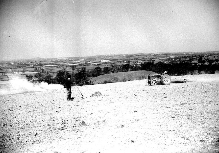 Farmworkers rolling and harrowing on the Burton Dassett hills.  April 19th 1955    IMAGE LOCATION: (Warwickshire County Record Office)
