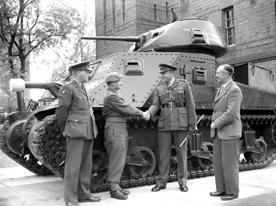 Lord Montgomery's tank at Budbrooke Barracks.  Left to right - Major J.W Crouch (R.A.O.C), Colonel C Sellars (Commandant, Central Ordnance Vehicle Depot), - who delivered the tank to - Colonel M.G.V Kendall, (Administrative Officer, Royal Warwicks Reg.), and Major C.F.C Bentley, ( O.C. Depot, Royal Warks. Regiment).  October 13th 1948 |  IMAGE LOCATION: (Warwickshire County Record Office) PEOPLE IN PHOTO: Sellars, Colonel C, Sellars as a surname, Kendall, Colonel M J V, Kendall as a surname, Crouch, Major J W, Crouch as a surname, Bentley, Major C F C, Bentley as a surname
