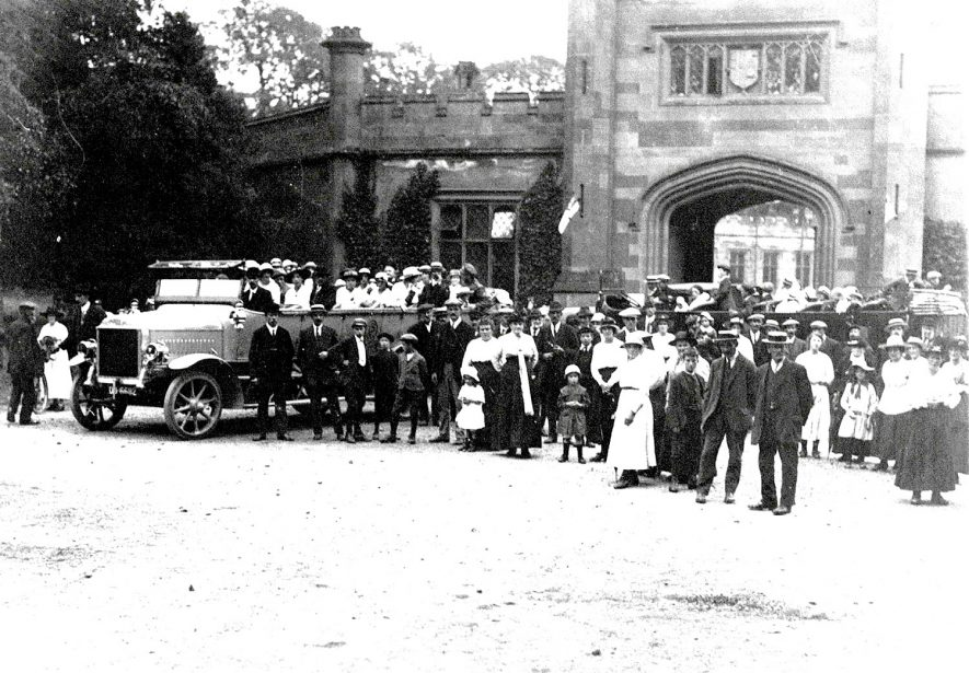 Group of people with a charabanc at Stoneleigh Abbey Mews. Circa 1926. |  IMAGE LOCATION: (Warwickshire County Record Office)