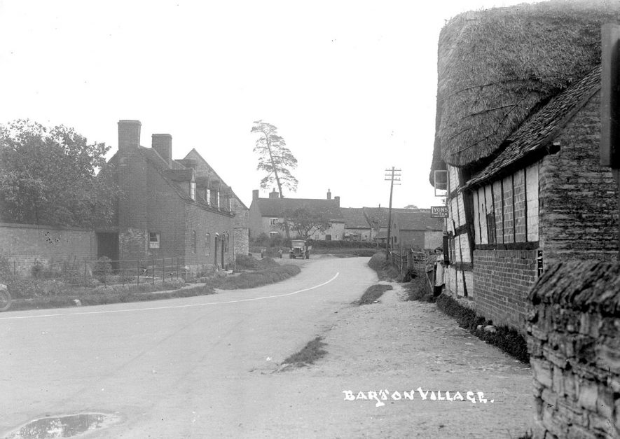 Village street in Barton. Shop or tea rooms on the right.  1930s |  IMAGE LOCATION: (Warwickshire County Record Office)