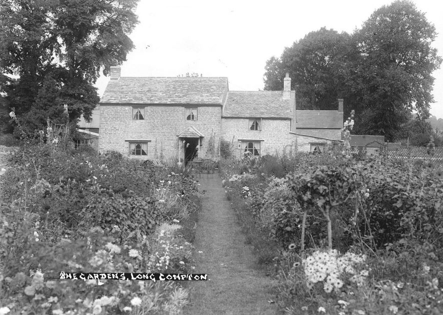 Cottage gardens at Long Compton.  1930s |  IMAGE LOCATION: (Warwickshire County Record Office)