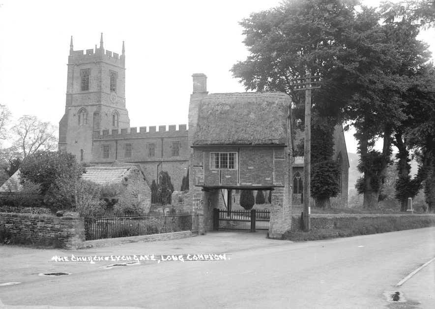 Exterior of the church of SS Peter & Paul, Long Compton, and the noted lych gate with rooms above.  1930s  |  IMAGE LOCATION: (Warwickshire County Record Office)
