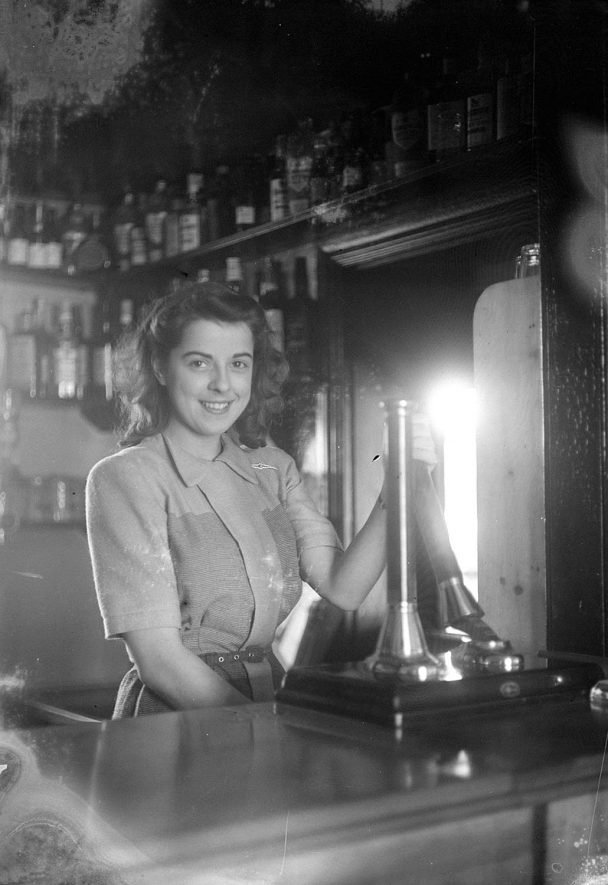 The barmaid at the Crown Inn, Haselor.  1930s |  IMAGE LOCATION: (Warwickshire County Record Office)