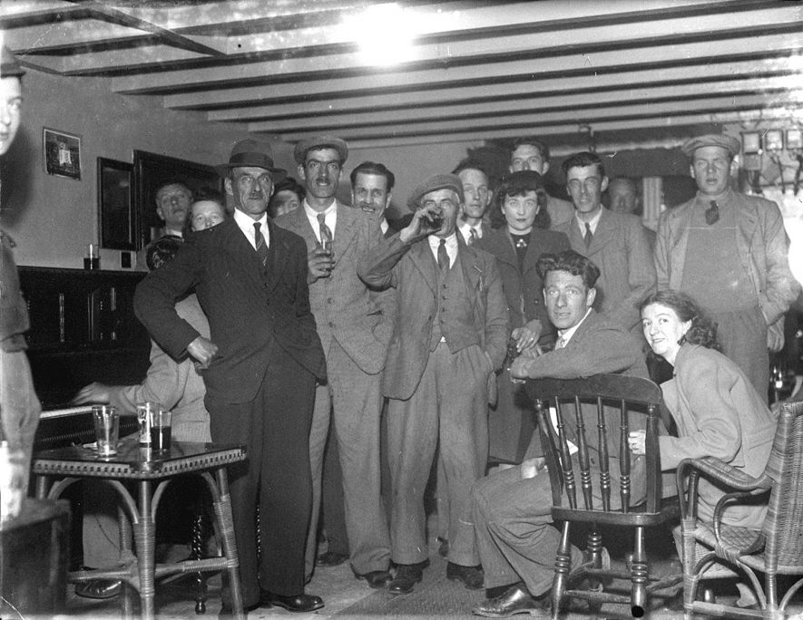 A party at the Crown Inn, Haselor.  1930s |  IMAGE LOCATION: (Warwickshire County Record Office)