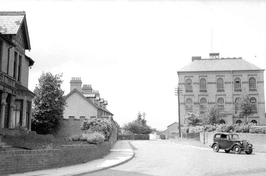 Minerva Needle Factory (built 1880), with a motor car in the road, Station Road, Alcester.  1950s |  IMAGE LOCATION: (Warwickshire County Record Office)