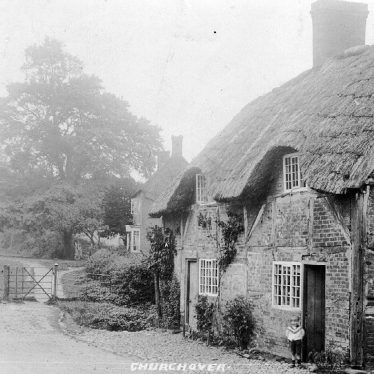 Churchover.  Timbered and thatched cottage