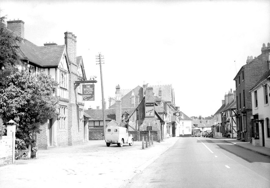 Evesham Street, showing pub on left hand side with delivery van, Alcester.  1950s |  IMAGE LOCATION: (Warwickshire County Record Office)