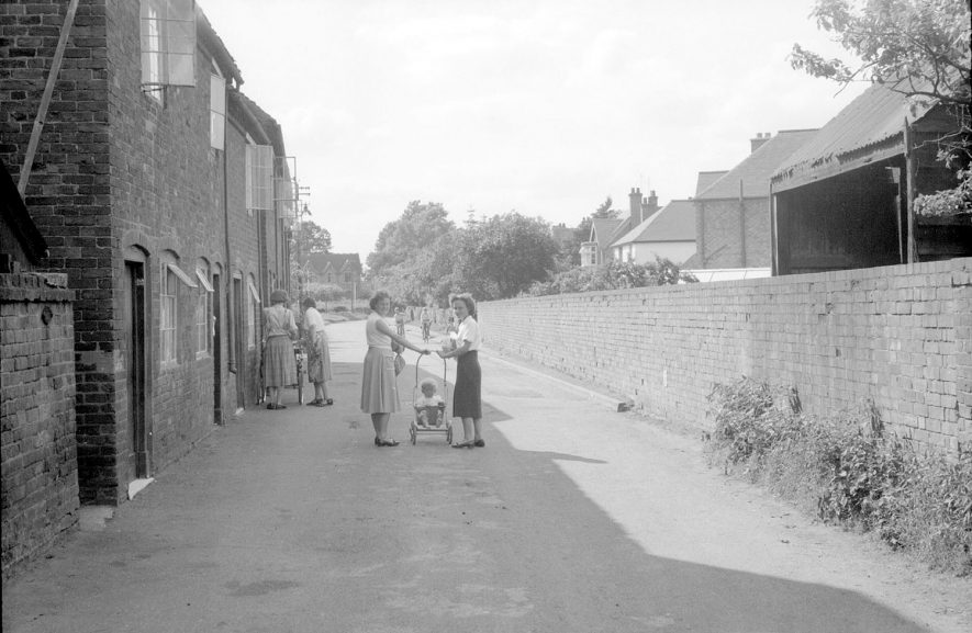 Moorfields, Alcester, showing houses and women with children in push chairs.  1950s |  IMAGE LOCATION: (Warwickshire County Record Office)