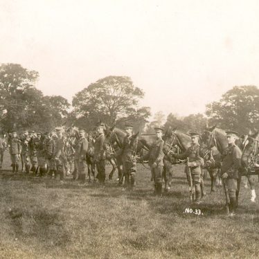 Warwick.  Troop of dismounted cavalry in a park