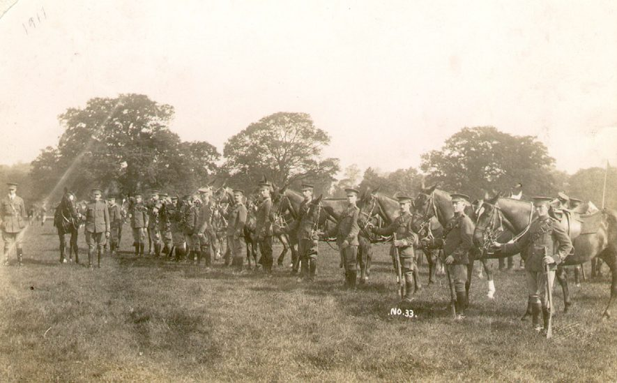 A troop of dismounted cavalry in a park at Warwick.  1910s |  IMAGE LOCATION: (Warwickshire County Record Office)