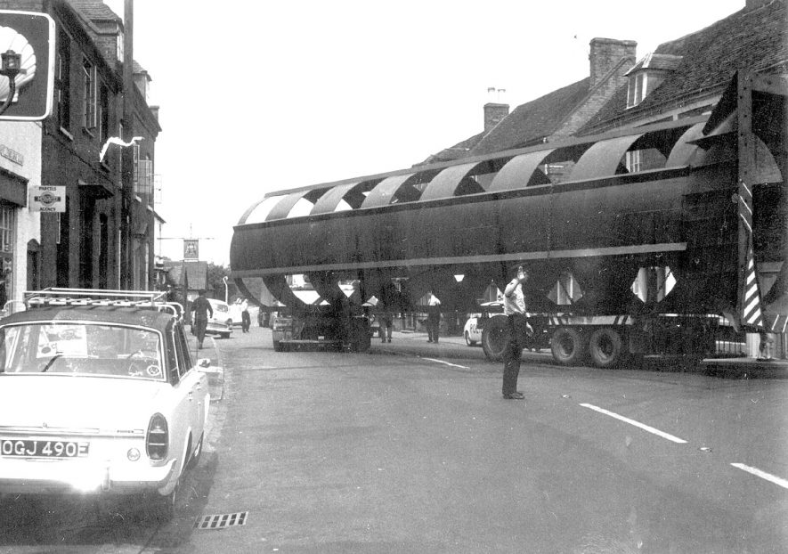 A large articulated lorry negotiating the Bridge Street/Church Street junction in Barford. Police are directing the operation.  1967 |  IMAGE LOCATION: (Warwickshire County Record Office)