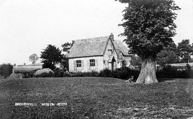 Broadwell Mission Room and school surrounded by fields. Boy under tree.  1910s |  IMAGE LOCATION: (Warwickshire County Record Office)