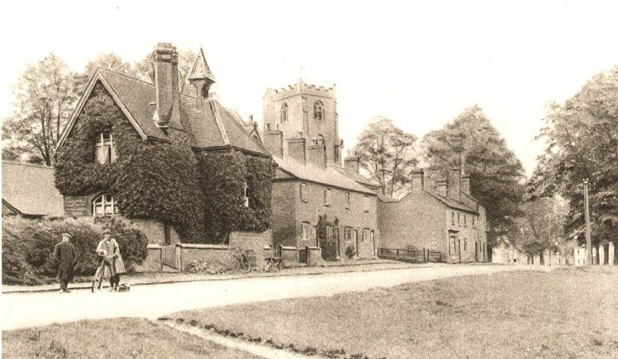 Brinklow schools. The church tower can also be seen behind the school buildings.  1910s |  IMAGE LOCATION: (Warwickshire County Record Office)
