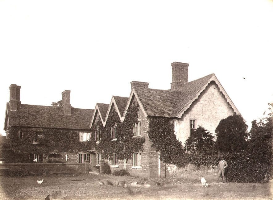 Mr Hughes standing at the rear of Broom Hall.  1890s |  IMAGE LOCATION: (Warwickshire County Record Office) PEOPLE IN PHOTO: Hughes, Mr, Hughes as a surname