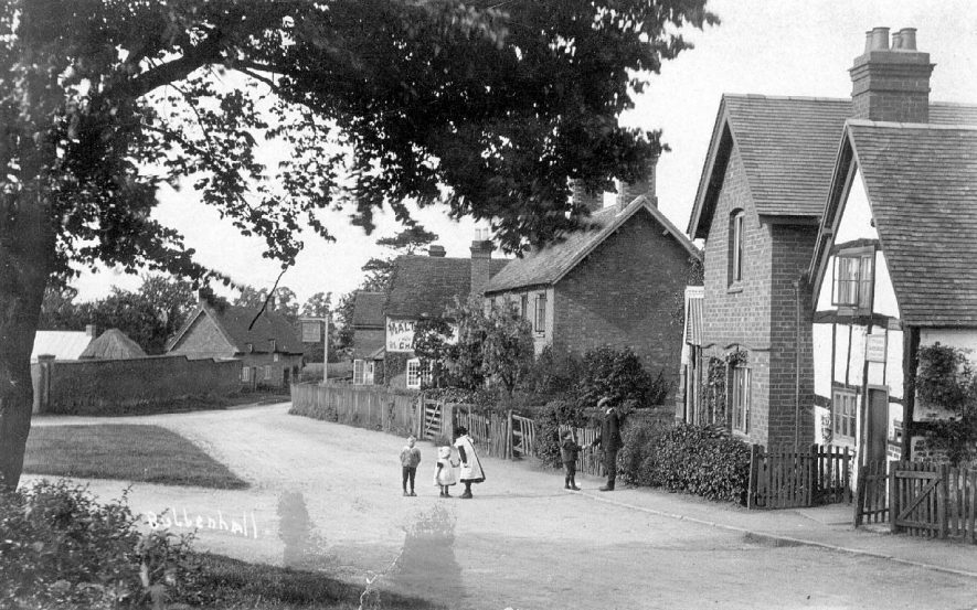 Bubbenhall village street with cottages and The Malt Shovel public house.. Children playing in street.  1900s |  IMAGE LOCATION: (Warwickshire County Record Office)