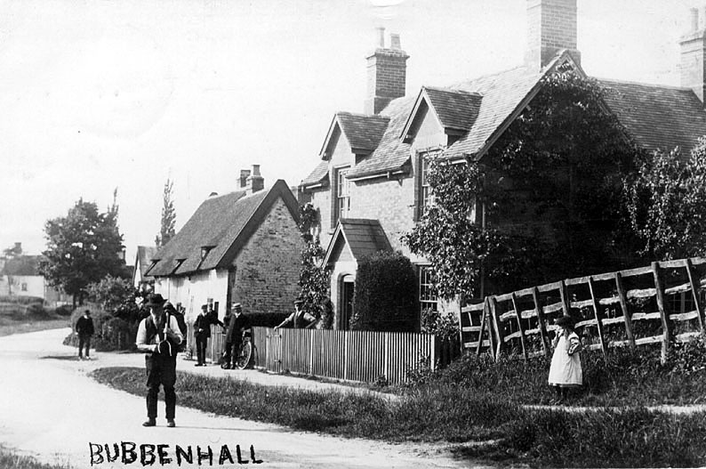 Bubbenhall village street with cottages and group of men.  1900s    IMAGE LOCATION: (Warwickshire County Record Office)