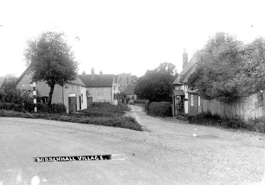 Bubbenhall Village, showing cottages . Church in distance.  1930s |  IMAGE LOCATION: (Warwickshire County Record Office)