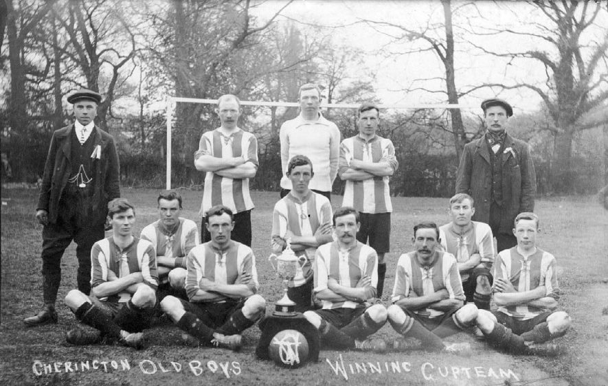 Cherington Old Boys winning football cup team with trophy.  1920s |  IMAGE LOCATION: (Warwickshire County Record Office)