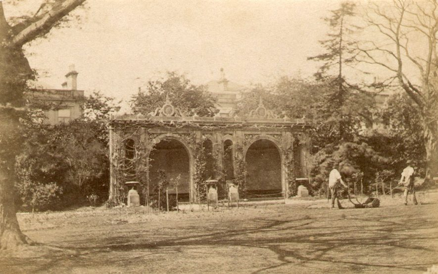 Loggia in Jephson gardens with gardeners mowing grass, Leamington Spa.  1870s |  IMAGE LOCATION: (Warwickshire County Record Office)