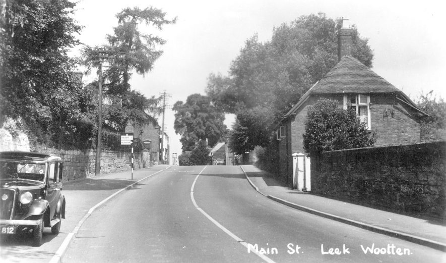Cottages and a car, Main Street, Leek Wootton.  1940s |  IMAGE LOCATION: (Warwickshire County Record Office)