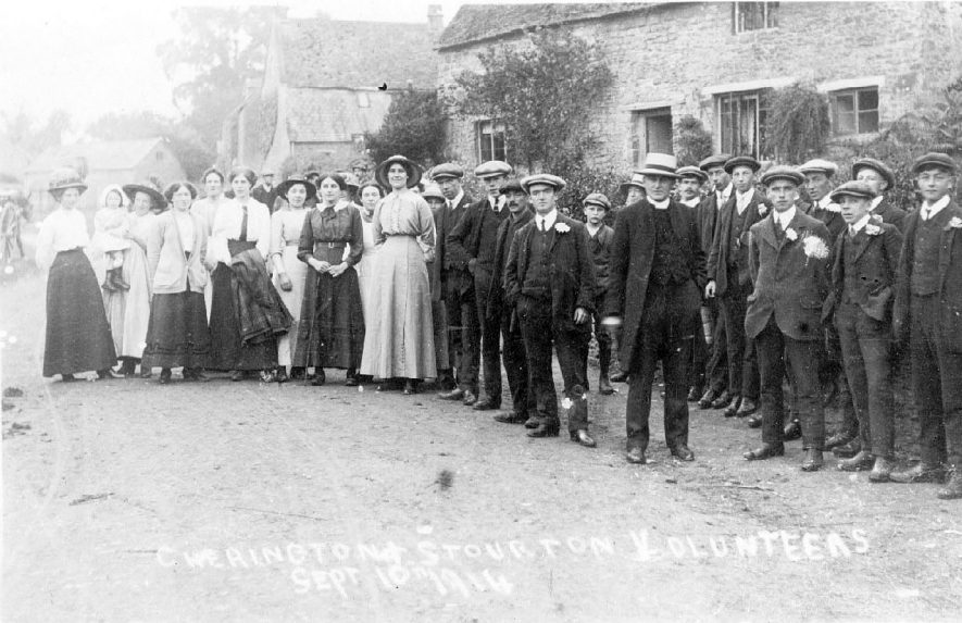 Cherington and Stourton Volunteers. Group of men and women standing in front of cottages.  September 10th 1914    IMAGE LOCATION: (Warwickshire County Record Office)