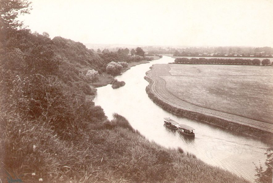 A steamboat towing a passenger boat on the River Avon, near to Marlcliff village.  Circa 1912 |  IMAGE LOCATION: (Warwickshire County Record Office)
