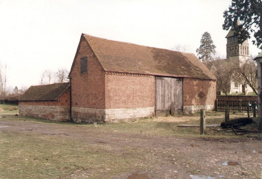 A barn at Park House farm, Old Milverton, with St James church in the background.  1984 |  IMAGE LOCATION: (Warwickshire County Record Office)