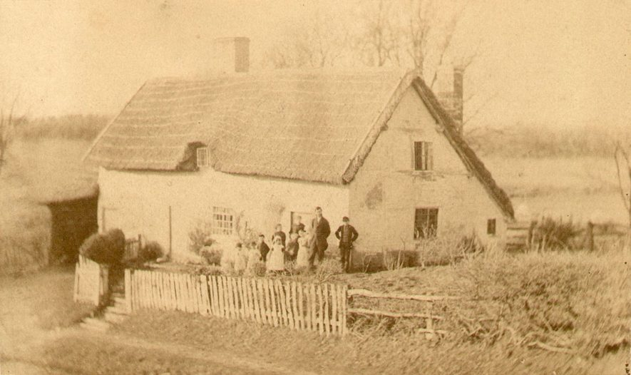 The school house at Morton Bagot, with the pupils standing in front. This school closed between 1876 and 1884. |  IMAGE LOCATION: (Warwickshire County Record Office)