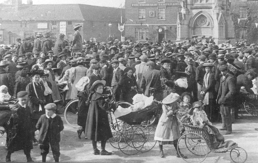 A meeting of Suffragettes in Rother Street, Stratford upon Avon, with a crowd of on-lookers including children with perambulators.  1913 |  IMAGE LOCATION: (Warwickshire County Record Office)