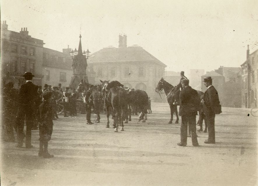 Soldiers and horses of The Warwickshire Yeomanry, in the Market Square, Warwick.  1900s |  IMAGE LOCATION: (Warwickshire County Record Office)