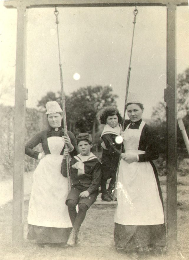 Rhoda Brain and Lucy Jones with two children on a swing at Myton, Warwick.  1900s    IMAGE LOCATION: (Warwickshire County Record Office) PEOPLE IN PHOTO: Jones, Lucy, Jones as a surname, Brain, Rhoda, Brain as a surname