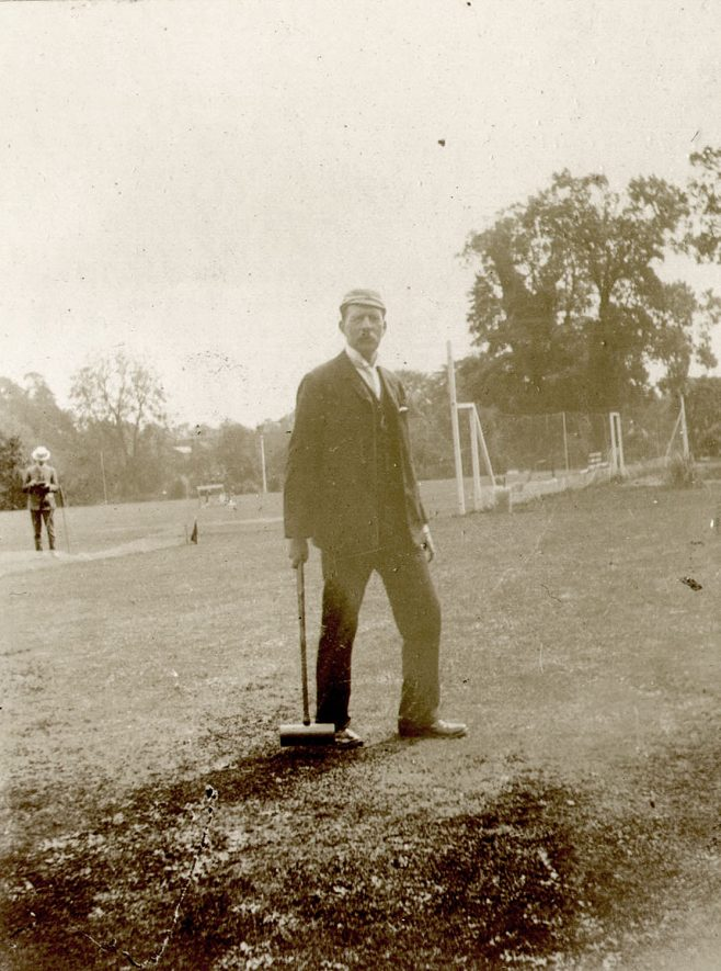 A man standing in the grounds of Warwick boat club.  1910s |  IMAGE LOCATION: (Warwickshire County Record Office)