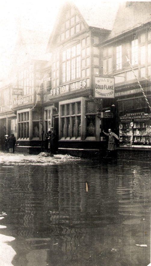 Shops in Queens Road, Nuneaton, after the floods.  1932 |  IMAGE LOCATION: (Warwickshire County Record Office)