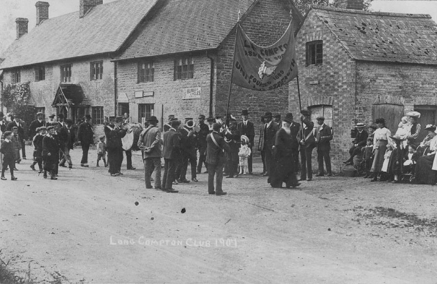 Procession of members of the Long Compton Assurance Society in front of the Post Office.  1907 |  IMAGE LOCATION: (Warwickshire County Record Office)