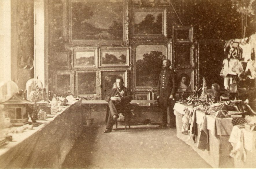 The interior of an unknown house in Stratford upon Avon. Two men are also in the picture.  1860s |  IMAGE LOCATION: (Warwickshire County Record Office)