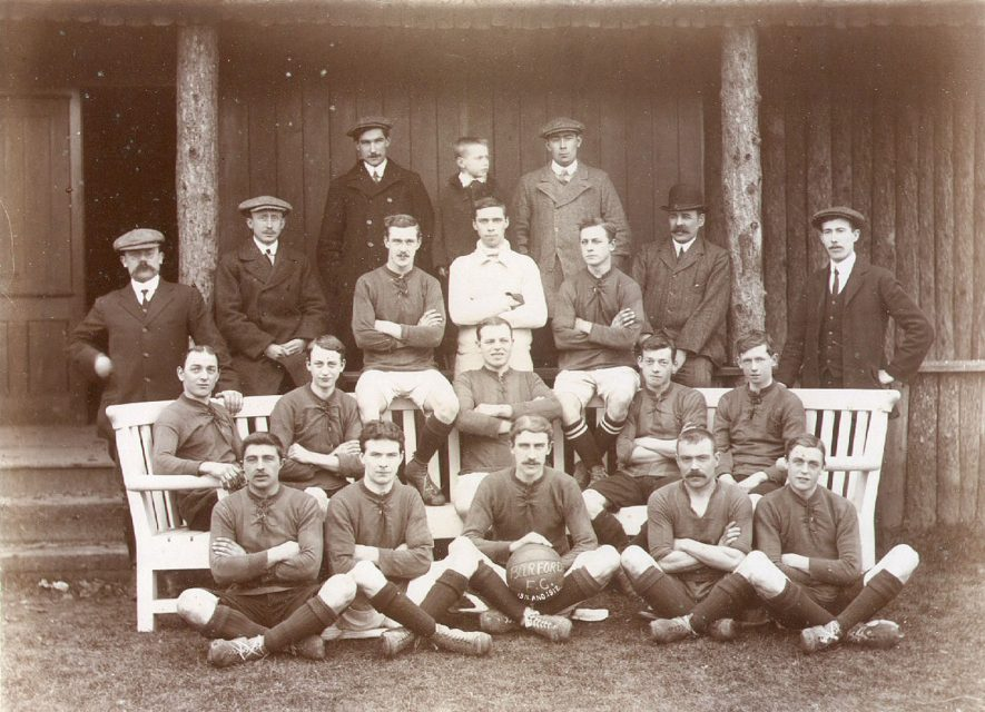 Barford football team. Front row, holding football - Mr J Harrison, back row, far right - Walter (Bob) Hemmings, middle row, far left - William Bacon, and next to him - Thomas Chadwick.  1911/1912 |  IMAGE LOCATION: (Warwickshire County Record Office) PEOPLE IN PHOTO: Hemmings, Walter, Hemmings as a surname, Harrison, Mr J, Harrison as a surname, Chadwick, Thomas, Chadwick as a surname, Bacon, William, Bacon as a surname