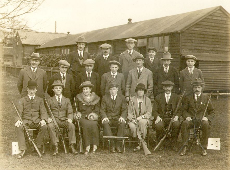 Members of the Barford miniature rifle club.  Back row, from left to right -   J. Harrison, W. Bacon, T. Chadwick, Douglas Taylor. Middle row - R. Jones (chairman), A. Ireland, C. Wall, S. Jukes, E. Chadwick, D. Taylor, S. Robinson. Front row - W. Hawksworth (range warden), S. Bromley (secretary), Mrs Hortin, A. Hunt (captain), Miss Hortin, B. Winston (vice-captain), C. Hunt.  1924/5 |  IMAGE LOCATION: (Warwickshire County Record Office) PEOPLE IN PHOTO: Winston, B, Winston as a surname, Wall, C, Wall as a surname, Taylor, Douglas, Taylor, D, Taylor as a surname, Robinson, S, Robinson as a surname, Jukes, S, Jukes as a surname, Jones, R, Jones as a surname, Ireland, A, Ireland as a surname, Hunt, C, Hunt, A, Hunt as a surname, Hortin, Mrs, Hortin, Miss, Hortin as a surname, Hemmings, Walter, Hemmings as a surname, Hawksworth, W, Hawksworth as a surname, Harrison, Mr J, Harrison as a surname, Chadwick, Thomas, Chadwick, E, Chadwick as a surname, Bromley, S, Bromley as a surname, Bacon, William, Bacon as a surname