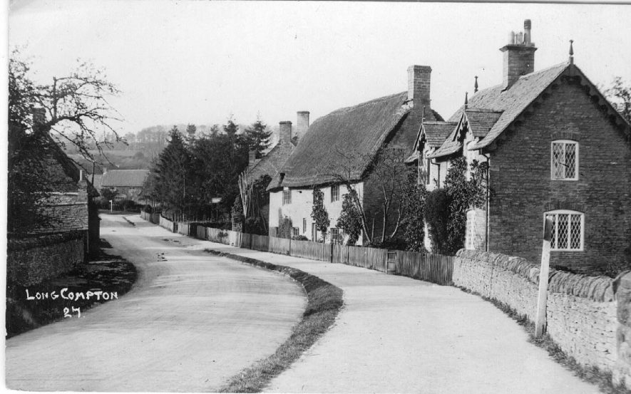 Village street in Long Compton. Notice the very wide footpath.  1910s |  IMAGE LOCATION: (Warwickshire County Record Office)