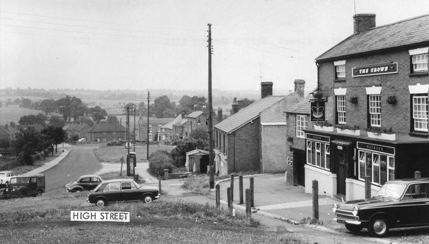 High Street, Napton on the Hill showing the Crown and cars parked on the street.  1960s
